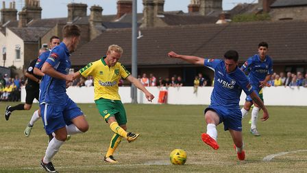 Alex Pritchard of Norwich has a shot on goal during the Pre-season Friendly match at Crown Meadow, L