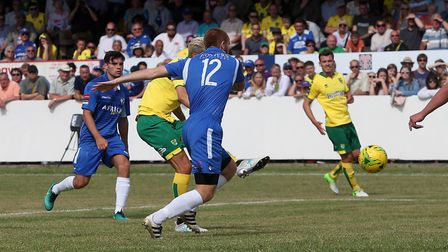 Mario Vrancic slots hom Norwich City's fifth goal during their pre-season friendly at Crown Meadow.