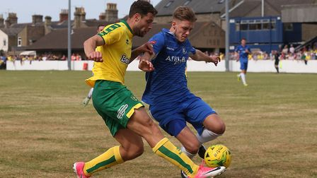 Yanic Wildschut of Norwich and Ollie Humphrey of Lowestoft Town in action during the Pre-season Frie