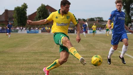 Yanic Wildschut of Norwich crosses the ball during the Pre-season Friendly match at Crown Meadow, Lo