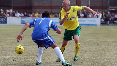 Steven Naismith of Norwich and Callum White of Lowestoft Town in action during the Pre-season Friend