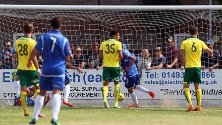 Travis Cole of Lowestoft Town scores his sides 1st goal during the Pre-season Friendly match at Crow
