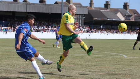 Harry Barker of Lowestoft Town clears the ball ahead of Steven Naismith of Norwich during the Pre-se