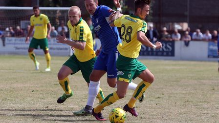 Jacek Zielonka of Lowestoft Town and James Maddison of Norwich in action during the Pre-season Frien