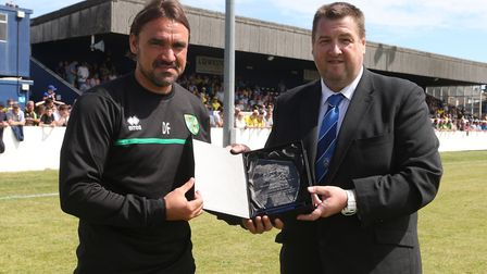 Norwich Manager Daniel Farke receives a plaque in recognition of Norwich taking part in the Pre-seas
