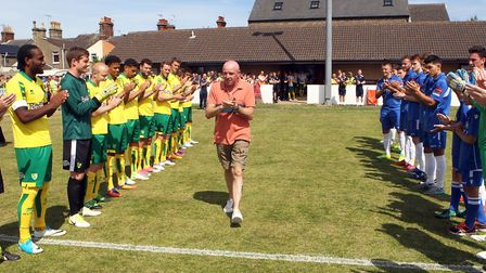 The players form a guard of honour for Lowestoft legend Micky Chapman before the pre-season friendly