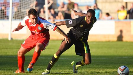 Action from the friendly clash between King's Lynn Town and Norwich City at The Walks last night. Fu