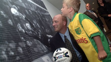 Bryan Gunn shows son Angus around the newly opened Gunn Club at Carrow Road back in 2000. Picture: A
