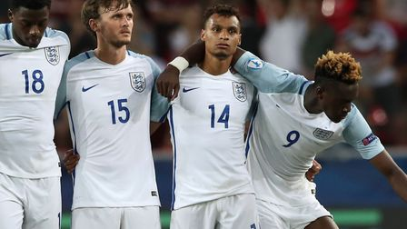 England players, including Norwich City's Jacob Murphy (number 14), look dejected after Nathan Redmo