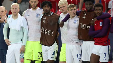 England players, including Norwich City loanee Angus Gunn (number 13), watch the penalty shoot out d