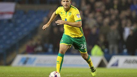 Michael Turner, pictured in EFL Cup action for Norwich at Leeds last season, is poised to join South