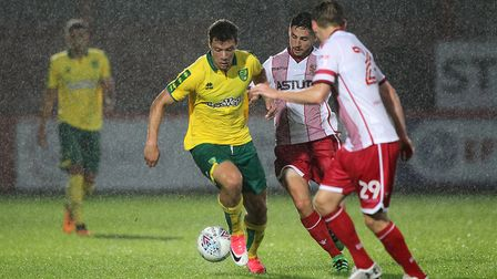 Yanic Wildschut battles in the puring rain during the second half of the friendly at the Lamex Stadi