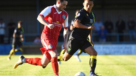 King's Lynn Town's Ryan Lennon is tracked by Norwich City U23s' Louis Ramsay at The Walks. Picture: