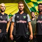 Norwich City trio, from left, Mario Vrancic, Ivo Pinto and Alex Tettey model Norwich City's new away