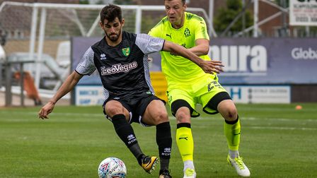 Nelson Oliveira of Norwich City and Josh Coulson of Cambridge United during the Pre-season Friendly
