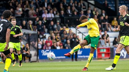 Josh Murphy of Norwich City shoots and scores the opening goal for Norwich City at Cambridge. Pictur