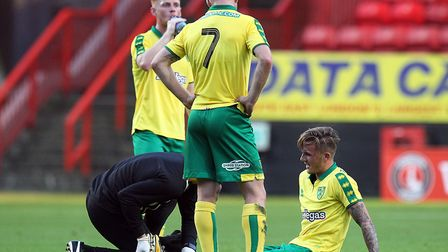 James Maddison of Norwich receives treatment for a knock during the pre-season friendly at The Valle