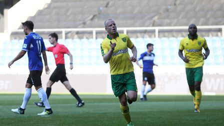 Steven Naismith celebrates firing Norwich 1-0 ahead during last night's friendly win over Arminia Bi