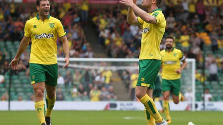 Marley Watkins of Norwich celebrates scoring his side's first goal during the pre-season friendly dr