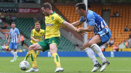 Marley Watkins of Norwich and Lewis Dunk of Brighton in action during the Pre-season Friendly match
