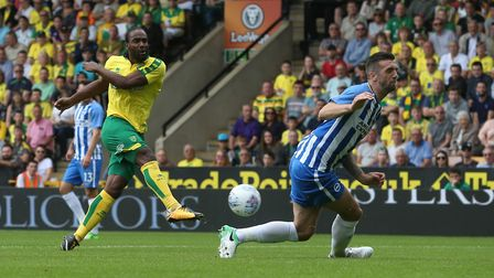 Cameron Jerome of Norwich has a shot on goal that is blocked by Shane Duffy of Brighton during the P