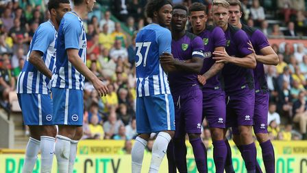 Chelsea loanee Izzy Brown (37) holds back the Norwich City tide for Brighton ahead of a late corner