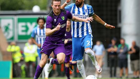 Marley Watkins of Norwich battles his way past Brighton right-back Bruno at Carrow Road. Picture by