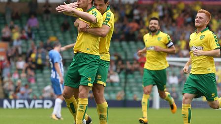 Marley Watkins is congratulated by Yanic Wildschut after equalising against Brighton at Carrow Road.