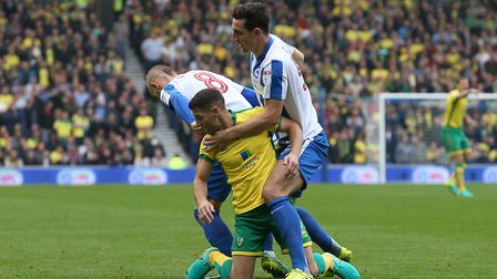 Centre-back Lewis Dunk, challenging Wes Hoolahan during Brightons 5-0 win over City last season, is