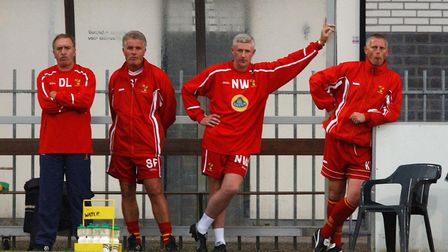 Norwich City's management team look on while the team suffer defeat on a tour to Holland. From left,