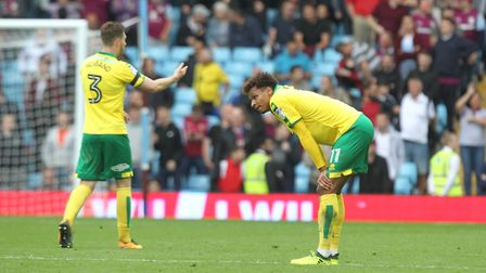 James Husband (left) and Josh Murphy look dejected after conceding Norwich City's fourth goal at Vil