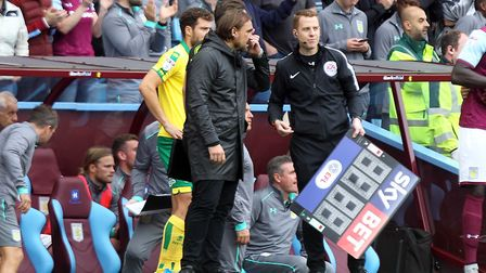 Norwich Head Coach Daniel Farke protests to Fourth Official Richard Hulme about handball in the buil