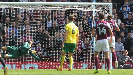 Angus Gunn of Norwich can only dive in vain as Andre Green of Aston Villa scores his sides 2nd goal
