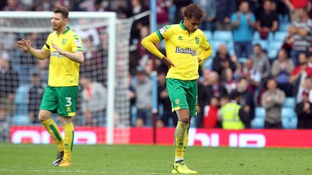 James Husband and Josh Murphy look around for answers as number four slips through Norwich City's fi