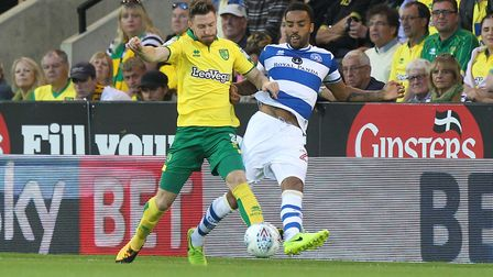 City new boy James Husband gets a foot in on QPR's James Perch.