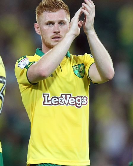 Harrison Reed of Norwich applauds the fans at the end of the Sky Bet Championship match at Carrow Ro