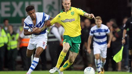 Darnell Furlong of Queens Park Rangers and Marley Watkins of Norwich in action during the Sky Bet Ch