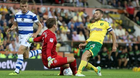 Alex Smithies of Queens Park Rangers saves at the feet of Wes Hoolahan of Norwich during the Sky Bet
