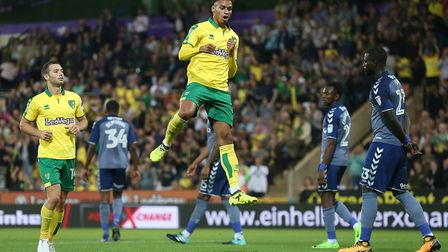 Josh Murphy jumps for joy after getting the Canaries back on level terms midway through the second h