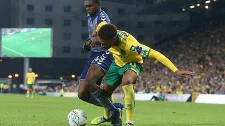 Anfernee Dijksteel of Charlton Athletic and Josh Murphy of Norwich in action during the Carabao Cup
