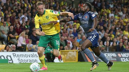Marco Stiepermann of Norwich and Tariqe Fosu of Charlton Athletic in action during the Carabao Cup m