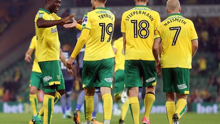 Alex Tettey congratulates Tom Trybull after the German midfielder put Norwich City 4-1 ahead late on