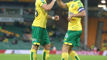 James Maddison celebrates scoring his side's third goal goal against Swindon with the man who made