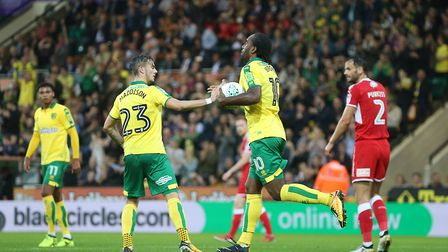 Cameron Jerome celebrates his goal with the man who made it, James Maddison.
