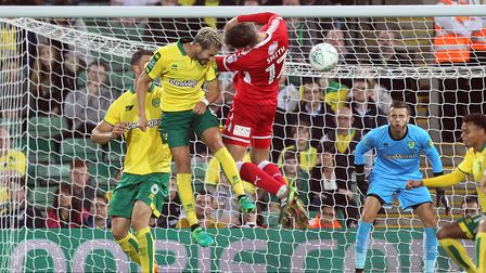 Mario Vrancic of Norwich and Harry Smith of Swindon Town in action during the Carabao Cup match at C