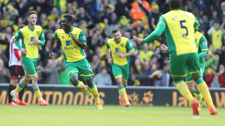 Alex Tettey and team-mates celebrate his wonder-goal against Sunderland. Picture: PA