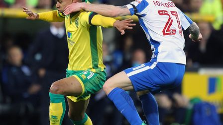 Oliver Norwood, pictured in action for Brighton at Carrow Road last season, has joined Fulham on loa