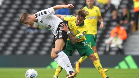 James Maddison tangles with Tom Cairney in Nowich City's 1-1 Championship draw at Fulham. Picture by