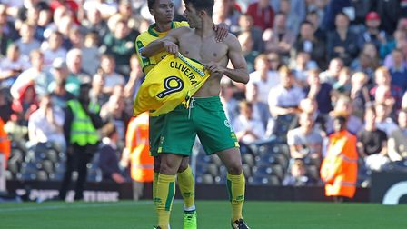 Nelson Oliveira of Norwich appears to be making a point to Norwich Head Coach Daniel Farke about who