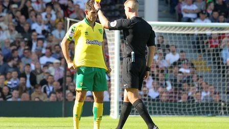Nelson Oliveira gets a yellow card from referee James Linington for taking his shirt off. Picture: P